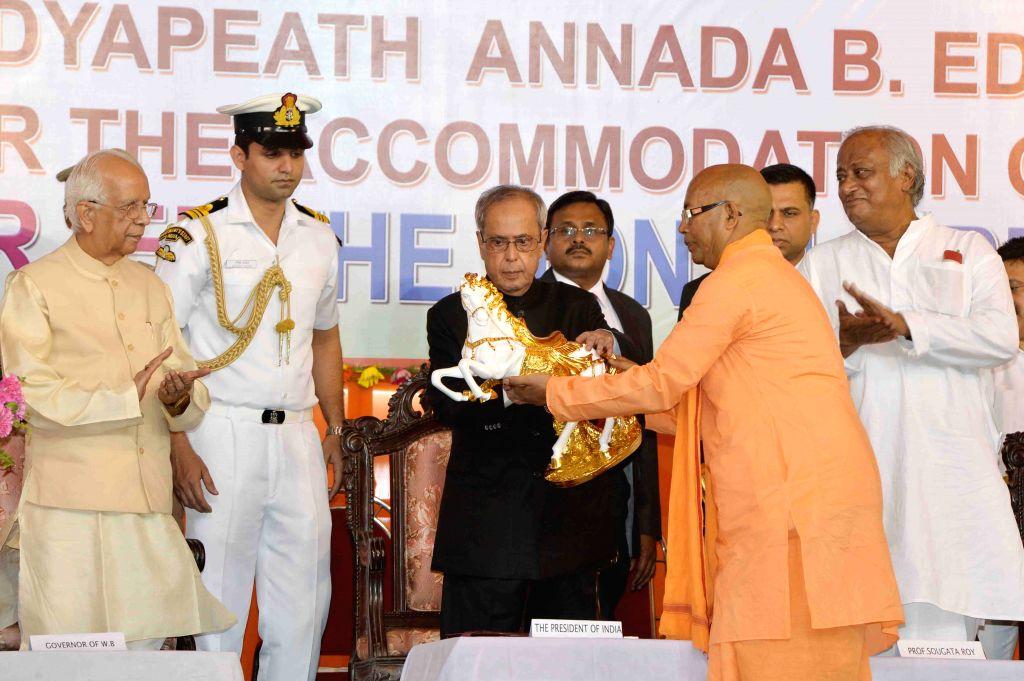 President Pranab Mukherjee being felicitated during inauguration of the centenary year celebration of Adyama's advent at Dakshineswar near Kolkata on April 2, 2015. The president also ... - Pranab Mukherjee, Keshari Nath Tripathi and Saugata Roy