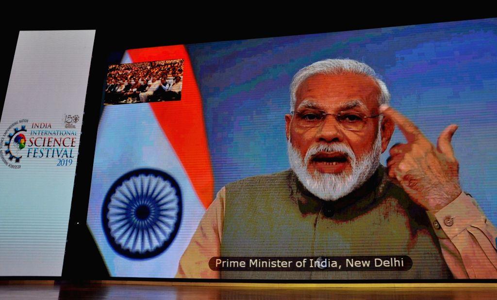 Kolkata: Prime Minister Narendra Modi addresses through a video conference at the India International Science Festival 2019 in Kolkata on Nov 5, 2019. (Photo: Kuntal Chakrabarty/IANS) - Narendra Modi