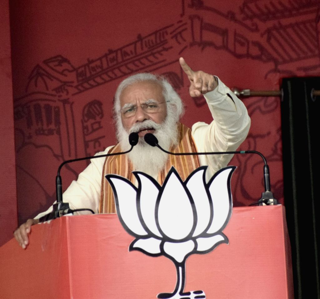 Kolkata: Prime Minister Narendra Modi at a public meeting during election campaign for State Assembly elections at Barasat in North 24 Parganas in West Bengal .(Photo:IANS) - Narendra Modi