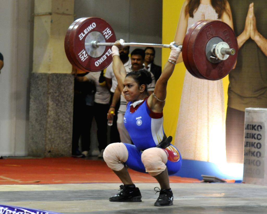 Kolkata: Rakhi Halder performs in the 64 Kg category during the Senior National Weight lifting Championship in Kolkata on Feb 5,2020.(Photo :IANS)