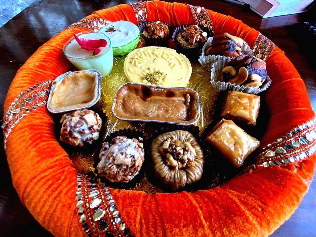 Kolkata : Raksha Bandhan-themed sweets on sale at a sweetmeat shop ahead of the festival in Kolkata on Aug 2, 2020.