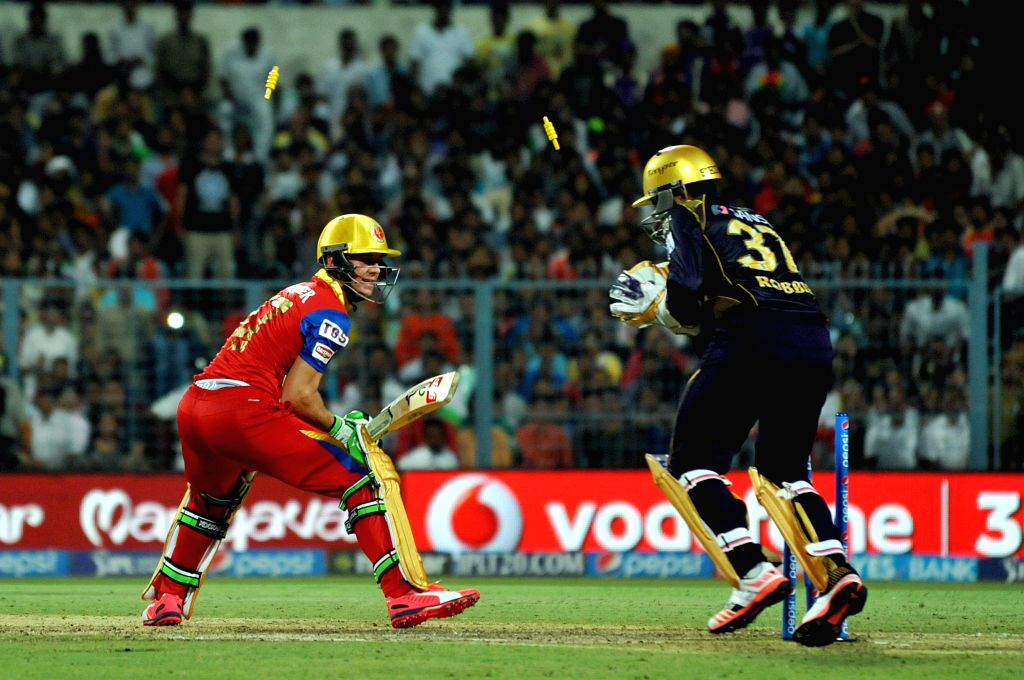 RCB batsman AB de Villiers being stamped out by KKR wicket-keeper Robit Uthappa during the IPL match between Kolkata Knight Riders (KKR) and Royal Challengers Bangalore (RCB) at Eden Gardens ...