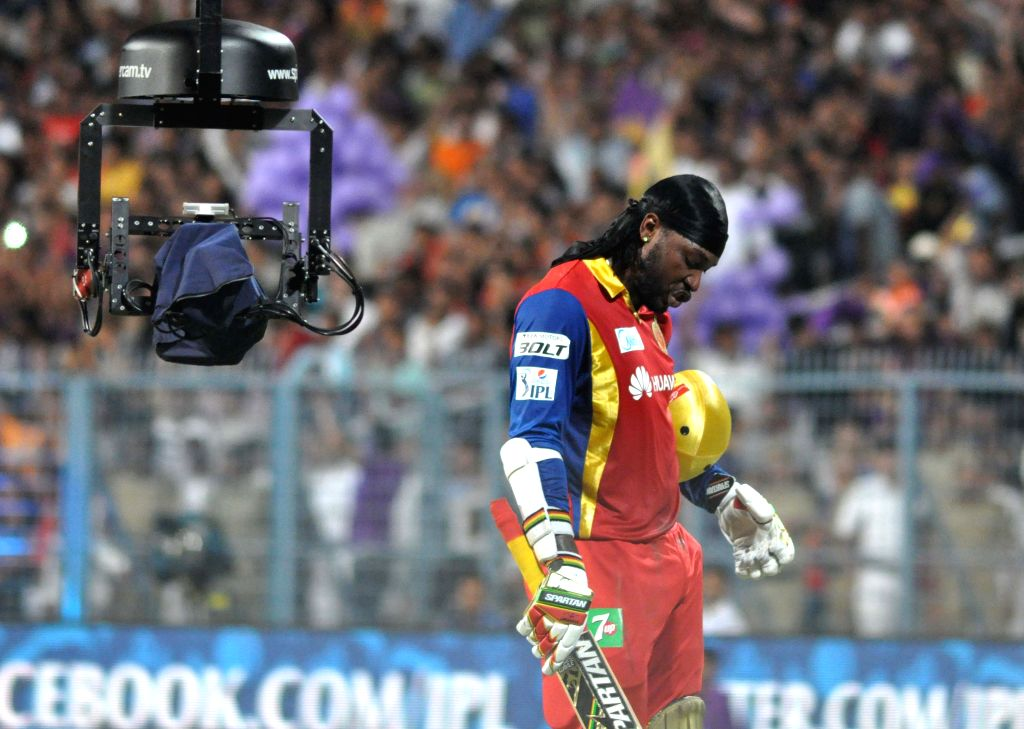 RCB batsman Chris Gayle in action during the IPL match between Kolkata Knight Riders (KKR) and Royal Challengers Bangalore (RCB) at Eden Gardens in Kolkata on April 11, 2015. - Chris Gayle