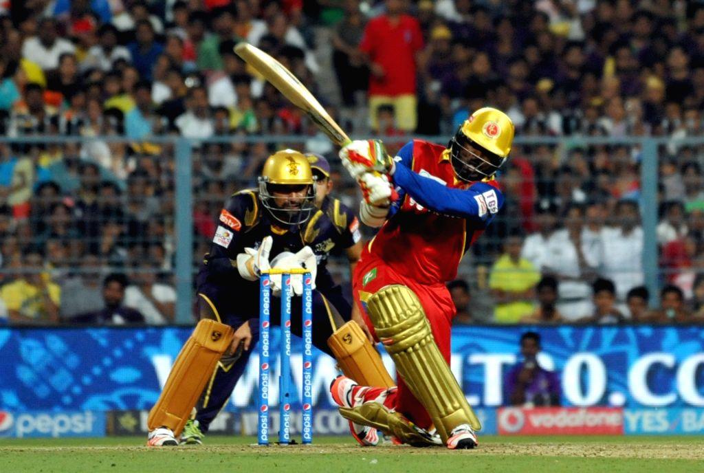 RCB batsman Chris Gayle in action during the IPL match between Kolkata Knight Riders (KKR) and Royal Challengers Bangalore (RCB) at Eden Gardens in Kolkata on April 11, 2015. - Chris Gayle