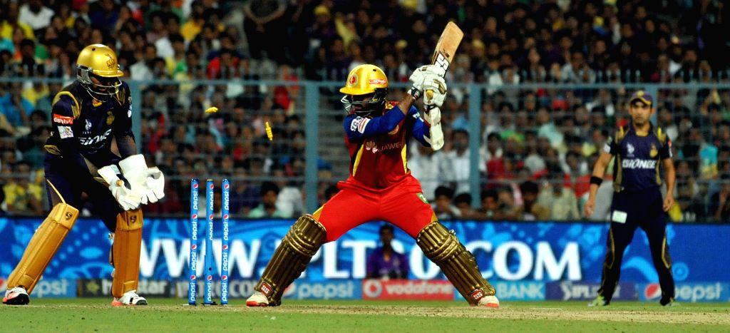 RCB batsman Dinesh Karthik bowled out during the IPL match between Kolkata Knight Riders (KKR) and Royal Challengers Bangalore (RCB) at Eden Gardens in Kolkata on April 11, 2015. - Dinesh Karthik