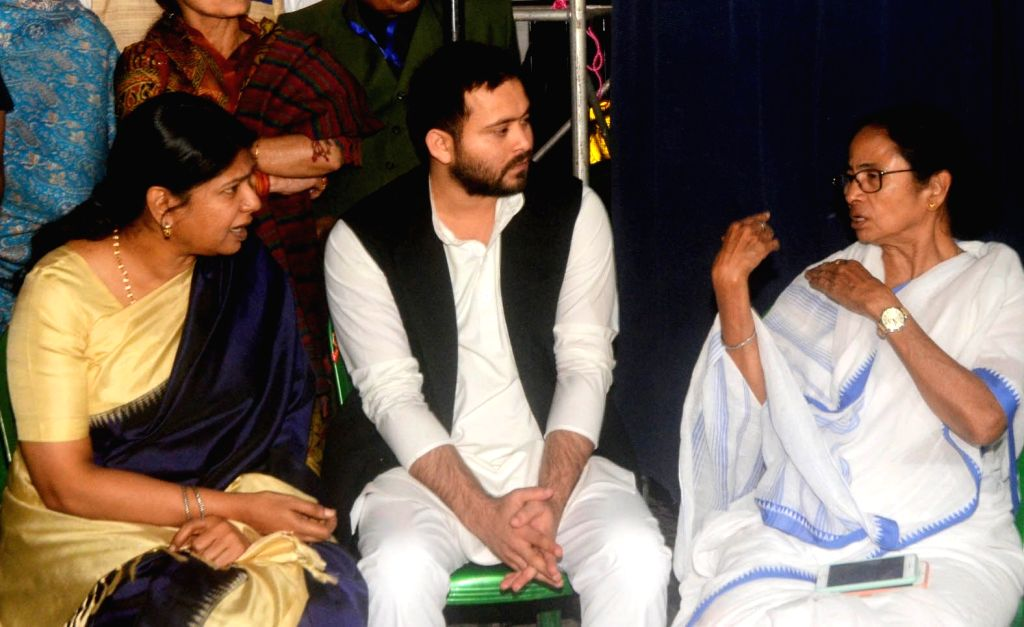 Kolkata: RJD leader Tejashwi Yadav and DMK Rajya Sabha MP Kanimozhi meets West Bengal Chief Minister Mamata Banerjee during a sit-in (dharna) demonstration over the CBI's attempt to question Kolkata Police Commissioner Rajeev Kumar in connection with - Mamata Banerjee and Tejashwi Yadav
