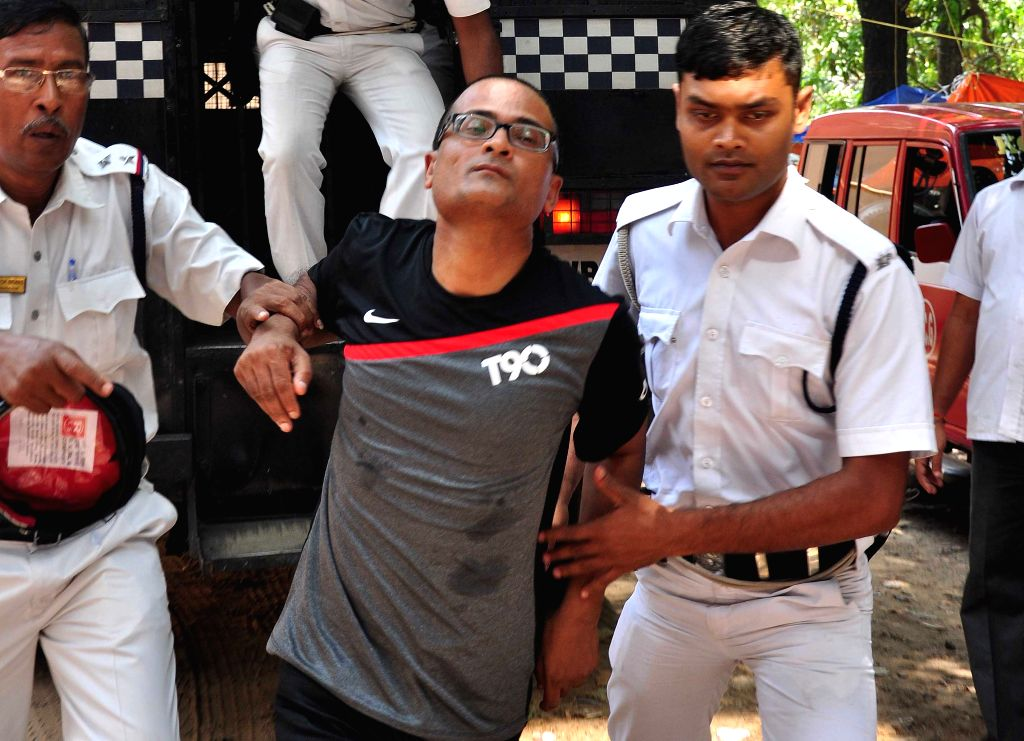 Rose Valley chairman Goutam Kundu being taken to be produced at a Kolkata Court on May 5, 2015.