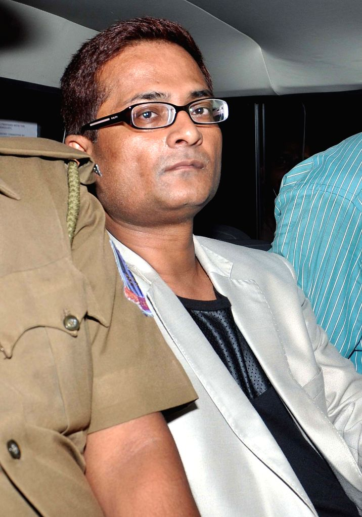 Rose Valley Group chairman Gautam Kundu arrives to appear before ED (Enforcement Directorate) in connection with a chit fund scam in Kolkata, on March 25, 2015. He was arrested by the ...