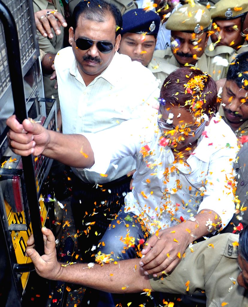 Rose Valley Group chairman Gautam Kundu being taken to be produced before a Kolkata court in connection with a chit fund scam, on March 26, 2015.
