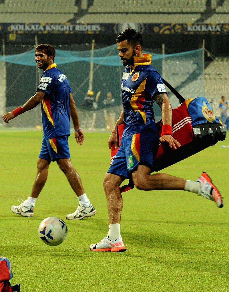 Royal Challengers Bangalore (RCB) captain Virat Kohli during a practice session at the Eden Gardens in Kolkata, on April 10, 2015. - Virat Kohli
