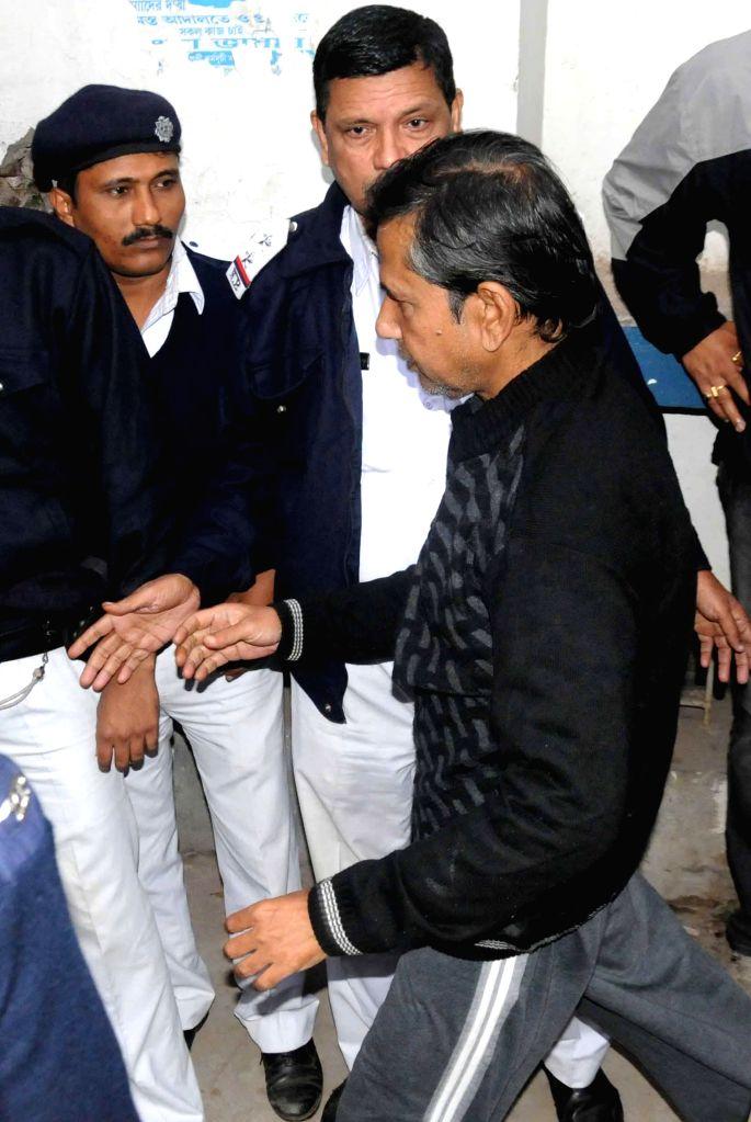 Saradha scam kingpin Sudipta Sen being taken to be produced before a Kolkata court on Jan 2, 2015.