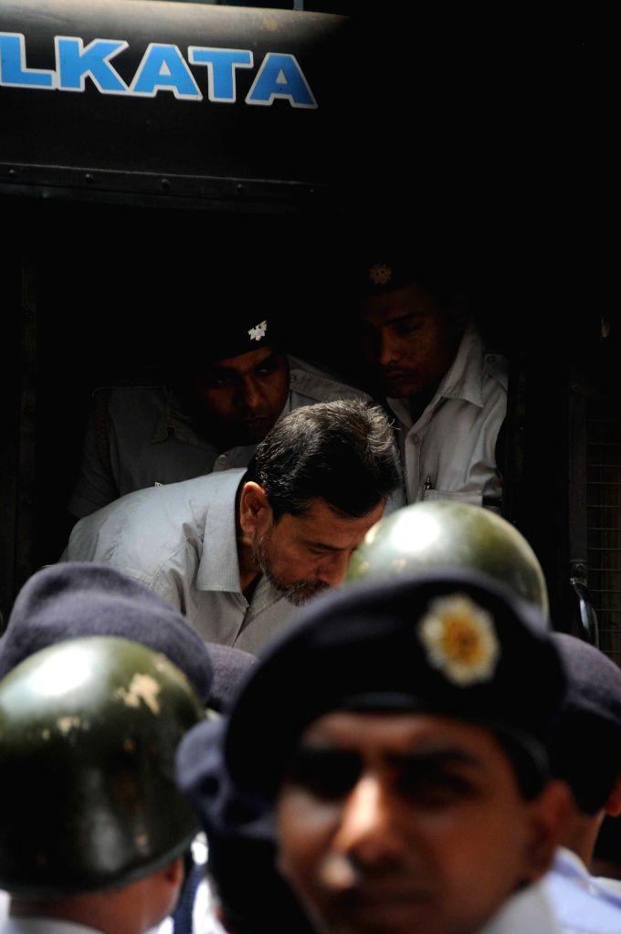 Saradha scam kingpin Sudipta Sen being taken to be produced before a Kolkata court on March 26, 2015.