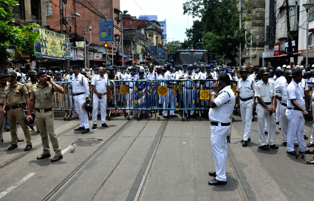 Kolkata: Security personnel deployed during BJP's protest march against the killing of its party men in West Bengal, from Lalbazar to Kolkata Police Headquarters on June 12, 2019. (Photo: Kuntal Chakrabarty/IANS)