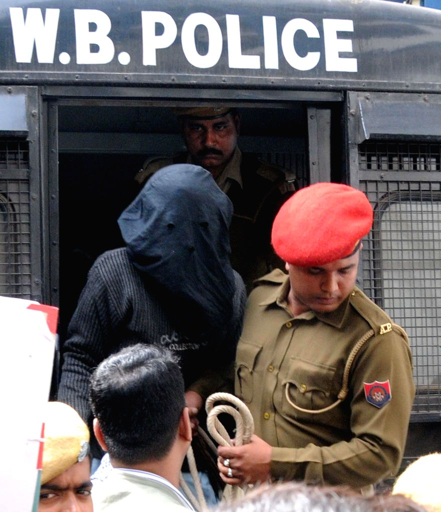 Security personnel produce three people to court who were arrested by NIA in Assam in connection with Burdwan blast in Kolkata on Jan. 3, 2015.