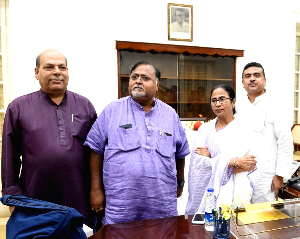 Kolkata: Senior West Bengal Congress leader Omprakash Mishra joins Trinamool Congress in the presence of West Bengal Chief Minister Mamata Banerjee and Education Minister Partha Chatterjee in Kolkata on Sep 4, 2019. (Photo: IANS) - Mamata Banerjee, Omprakash Mishra and Partha Chatterjee