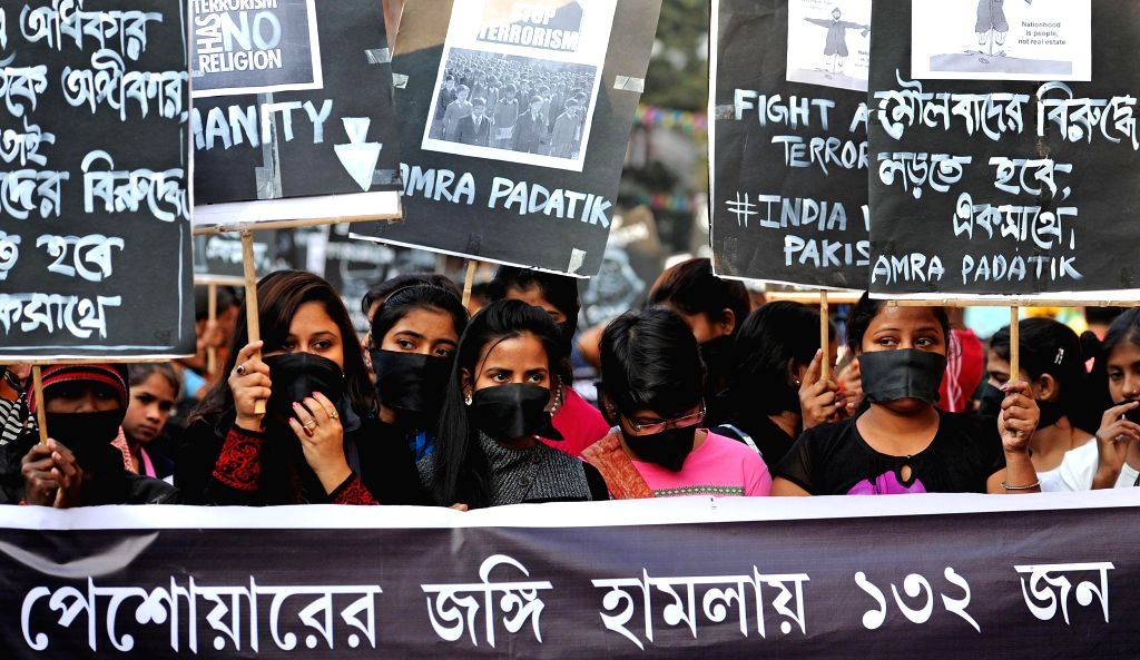 Sex workers participate in a rally to condemn recent attack on a Peshawar school that left 148 dead, mostly children, at Shobhabazar in Kolkata, on Dec 20, 2014.