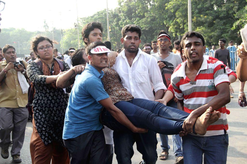 SFI activists injured in police lathi-charge being taken away in Kolkata, on April 2, 2015.