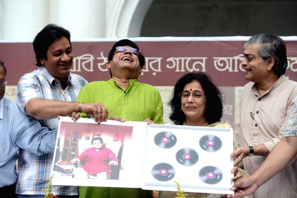 Singer Aarti Mukherji and filmmaker Sandip Ray at the release of Amit Kumar's first Rabindra Sangeet album in Kolkata, on April 12, 2015.