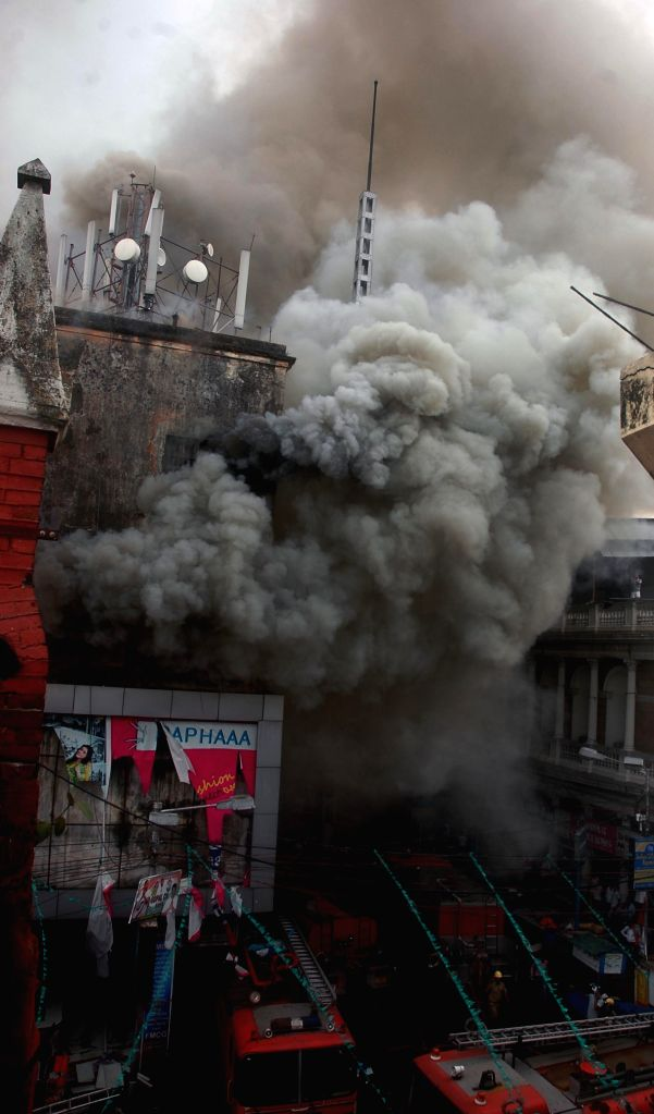 Smoke billows out of a Kolkata Shopping Mall after a fire broke out on April 26, 2015.
