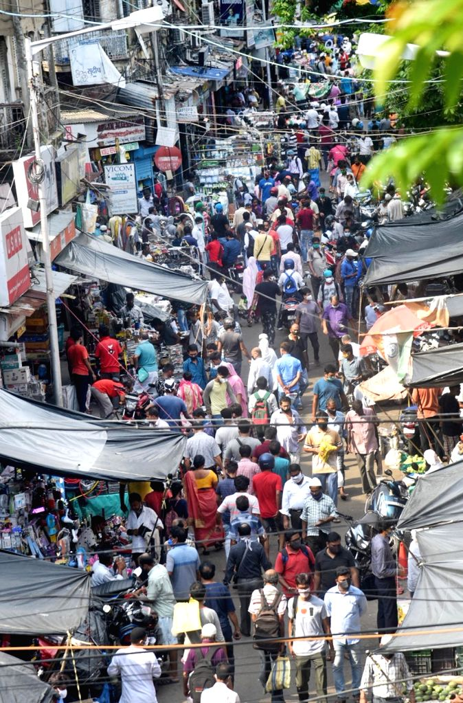 Kolkata : Social distancing goes for a toss at Chandni Chowk in Kolkata's Bowbazar amid complete lockdown across COVID-19 containment zones in West Bengal, on July 31, 2020.