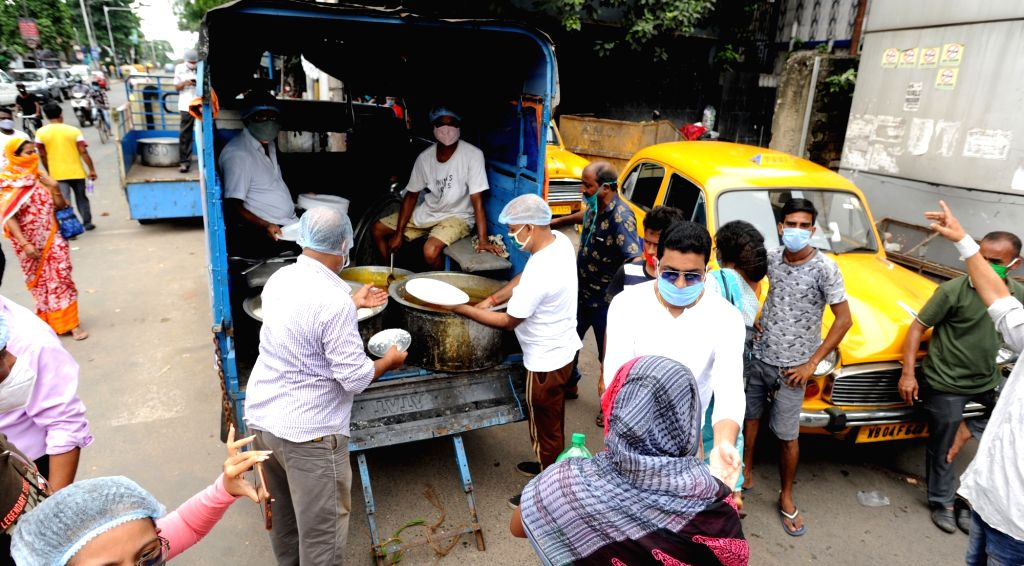 Kolkata : Social workers of an NGO named Humanity distribute food among the family members of COVID-19 patients at R.G. Kor Medical College & Hospital, in Kolkata on Aug 31, 2020.