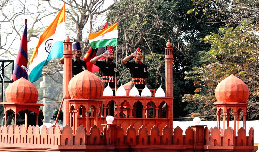 Soldiers aboard a tableau representing the Red fort during the Republic Day parade organised at Red Road in Kolkata on Jan 26, 2015.