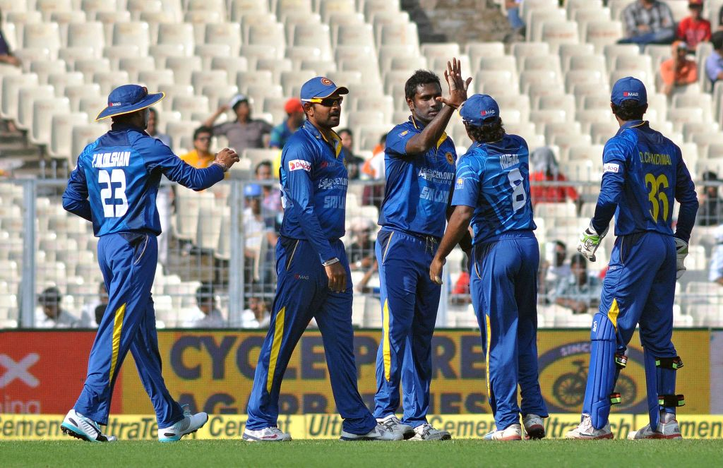 Sri Lankan players celebrate fall of a wicket during the 4th ODI between India and Sri Lanka at the Eden Gardens in Kolkata, on Nov 13, 2014.