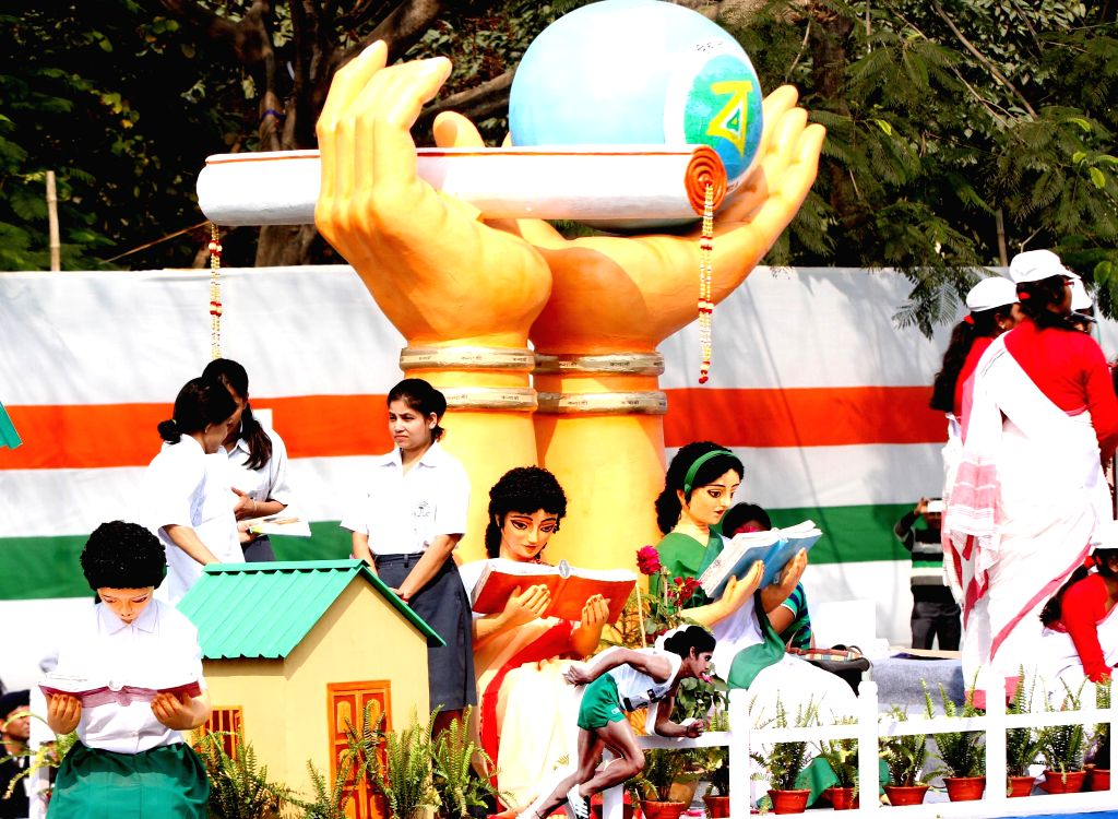 Students aboard a Republic Day tableau at Red Road in Kolkata on Jan 26, 2015.