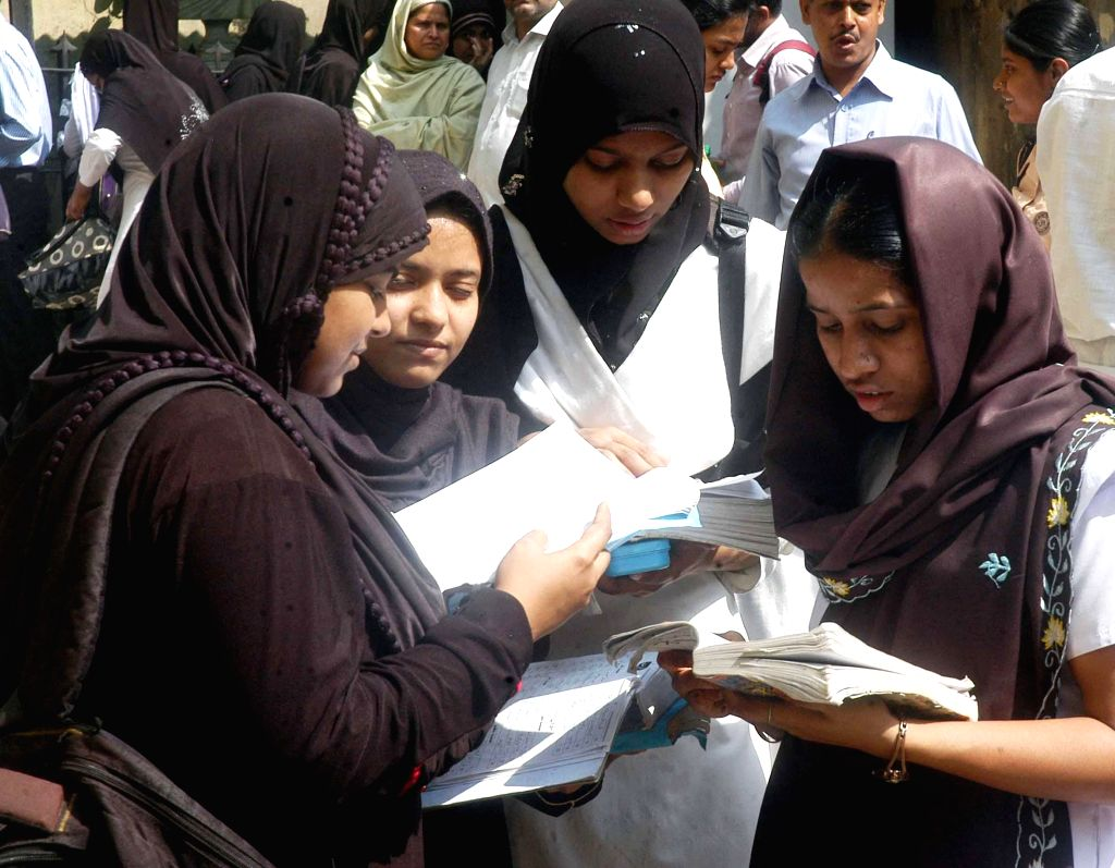 Students during last minute revision ahead of their Madhyamik (West Bengal board class X) exam in Kolkata, on Feb 23, 2015.