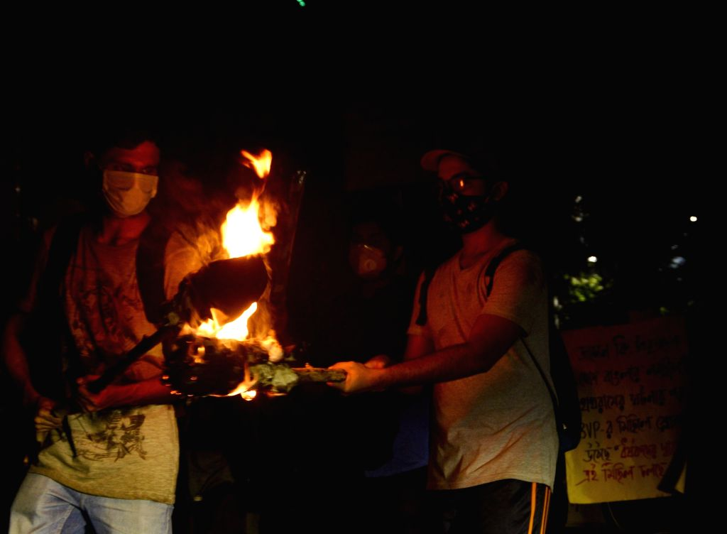 Kolkata : Students of Jadavpur University participate in a torchlight rally to protest against the alleged gang rape & murder of a 19-year-old Dalit girl in Uttar Pradesh's Hathras; in Kolkata on ...