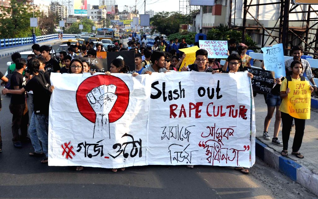 Students participate in a rally to protest against violence against women in Kolkata, on April 2, 2015.