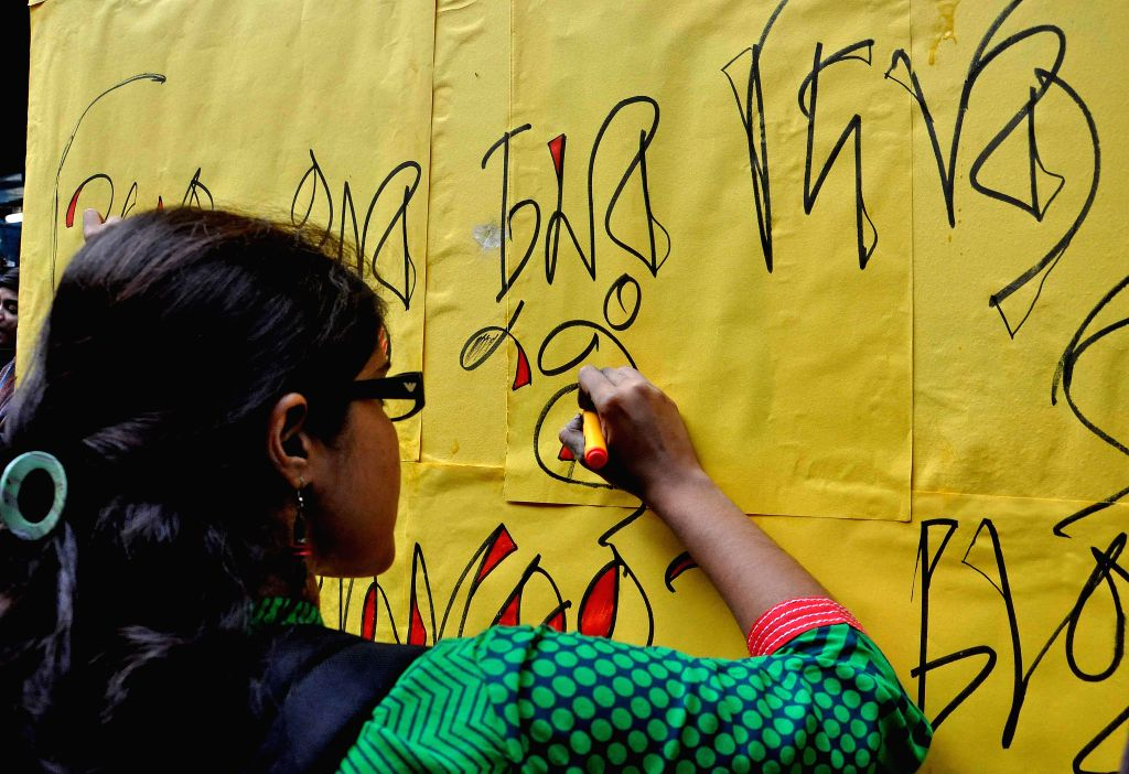 """Students participate in """"Kiss of Love"""" - a protest to deride moral policing in Kolkata, on Nov 5, 2014."""