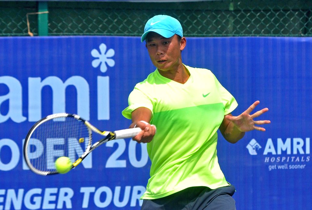 Taiwanese tennis player Chen Ti in action against Radu Albot of Moldova during an Emami Kolkata Open 2015- ATP Challenger semi-final match in Kolkata on Feb 27, 2015.