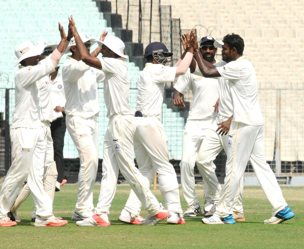 Tamil Nadu cricketers celebrate after defeating Maharashtra in Ranji Trophy Semi-final at Eden Gardens in Kolkata, on March 1, 2015.