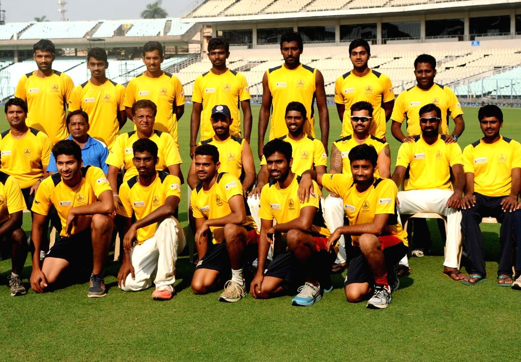 Tamil Nadu cricketers pose for a group photo after defeating Maharashtra in Ranji Trophy Semi-final at Eden Gardens in Kolkata, on March 1, 2015.