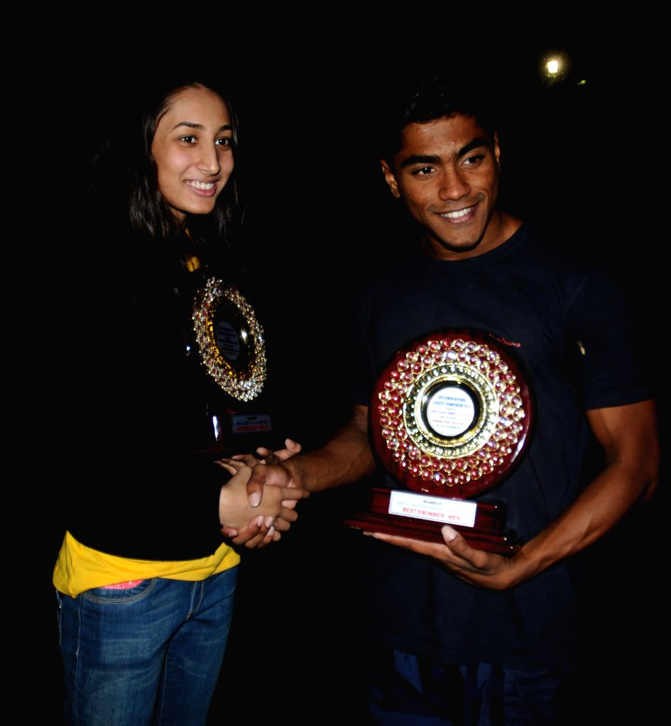 The 68th Senior National Aquatic Champions, Madhu P S (R) in women's category and Manna Patel (L) in men's category in Kolkata, on Nov 16, 2014. - Patel