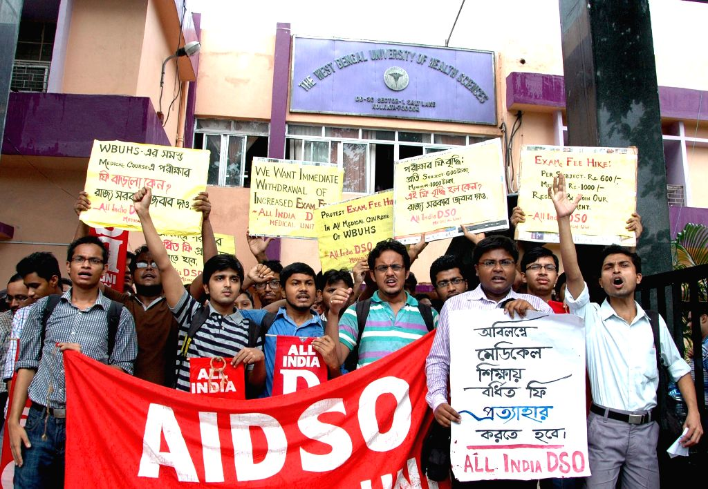 The activists of AIDSO participate in a protest rally against West Bengal Government against fee hike in medical education in Kolkata on June 19, 2015.