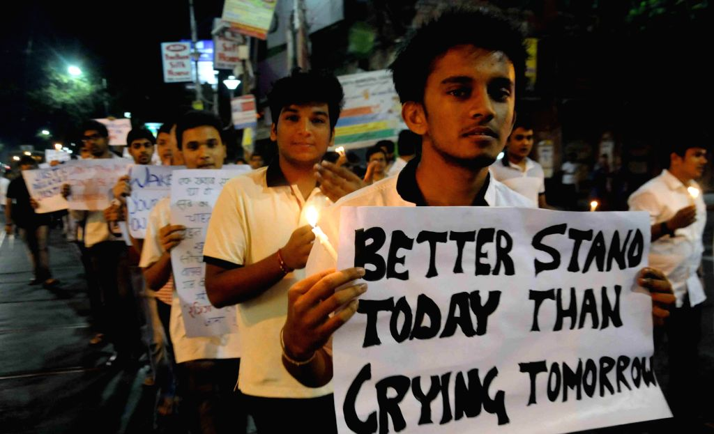 The activists of Society Against Violence in Education (SAVE) participate in candle light march to protest against ragging in Kolkata, on Nov 23, 2014.