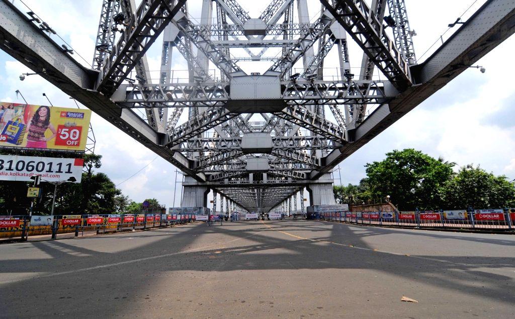 Kolkata : The Howrah Bridge bears a deserted look during the biweekly COVID-19 lockdown in Kolkata on Aug 31, 2020.