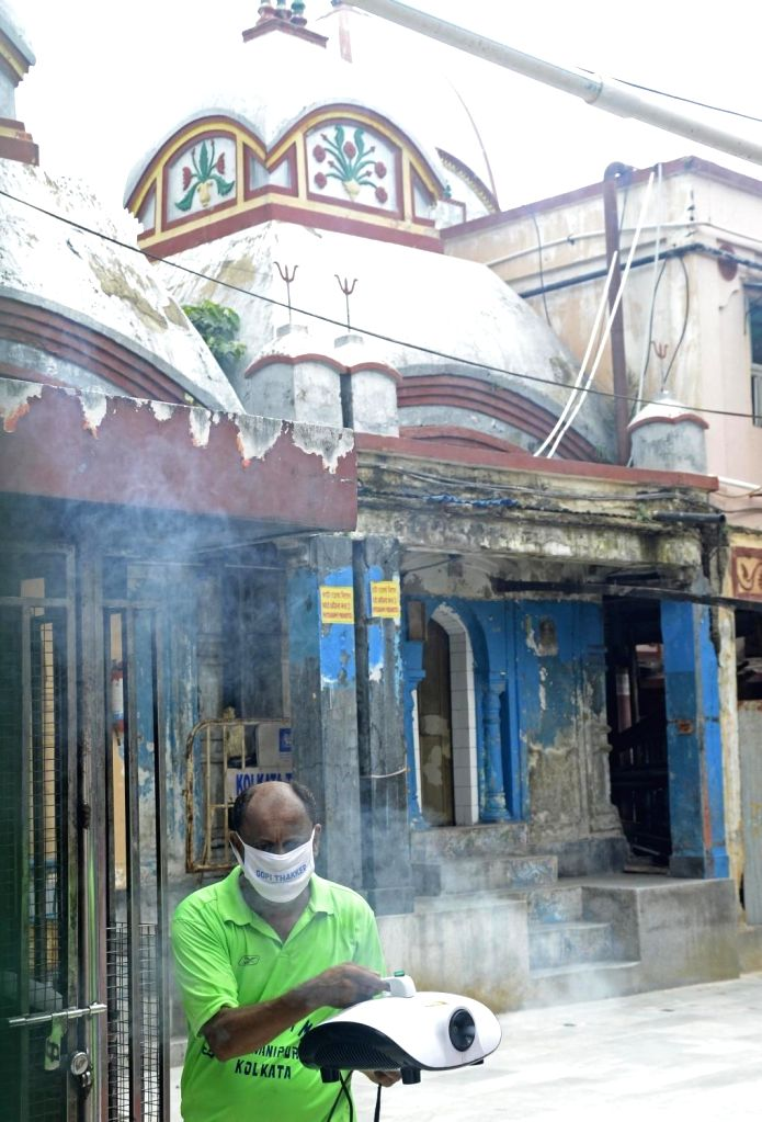 Kolkata: The Kalighat Kali temple being sanitised as it gears up to re-open for the devotees, amid Unlock 1.0 or phased relaxation during the fifth phase of the nationwide lockdown imposed to mitigate the spread of coronavirus, in Kolkata on June 30,