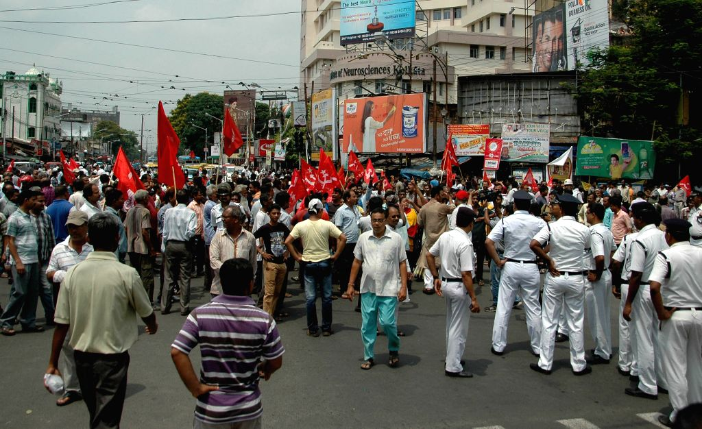 The Leftist activists blocked the road at Mullick Bazar during a 12 hour general strike called by opposition parties in Kolkata on April 30, 2015.