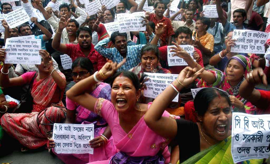 The members of All Bengal Chit Fund Depositors and Agent Forum stage a demonstration in front of West Bengal assembly in Kolkata, on June 12, 2015.