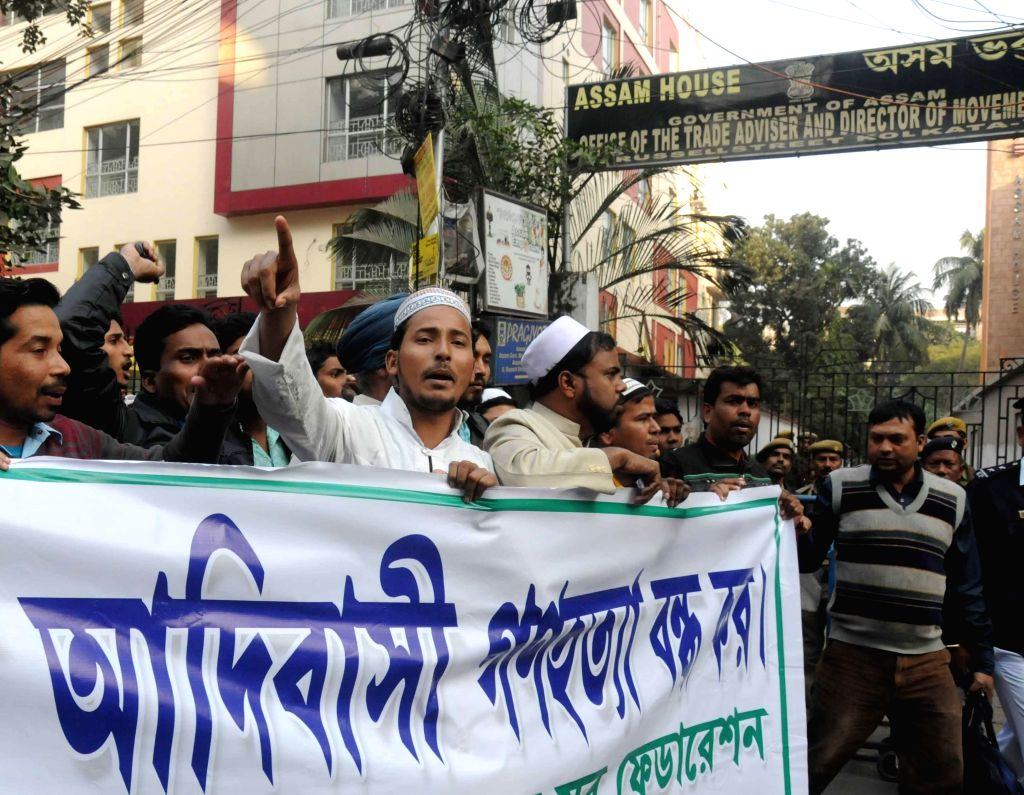 The members of All Bengal Minorities Youth Federation protest against the recent Assam violence in which 73 people were killed, in front of Assam House in Kolkata, on Dec 29, 2014.