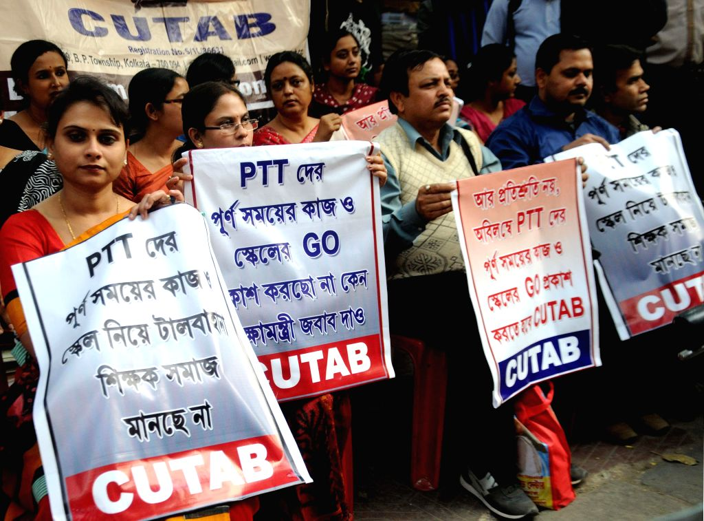 The members of College and University Teacher`s Association (CUTAB) participate in a protest against the West Bengal Government at college square in Kolkata, on Feb 10, 2015.