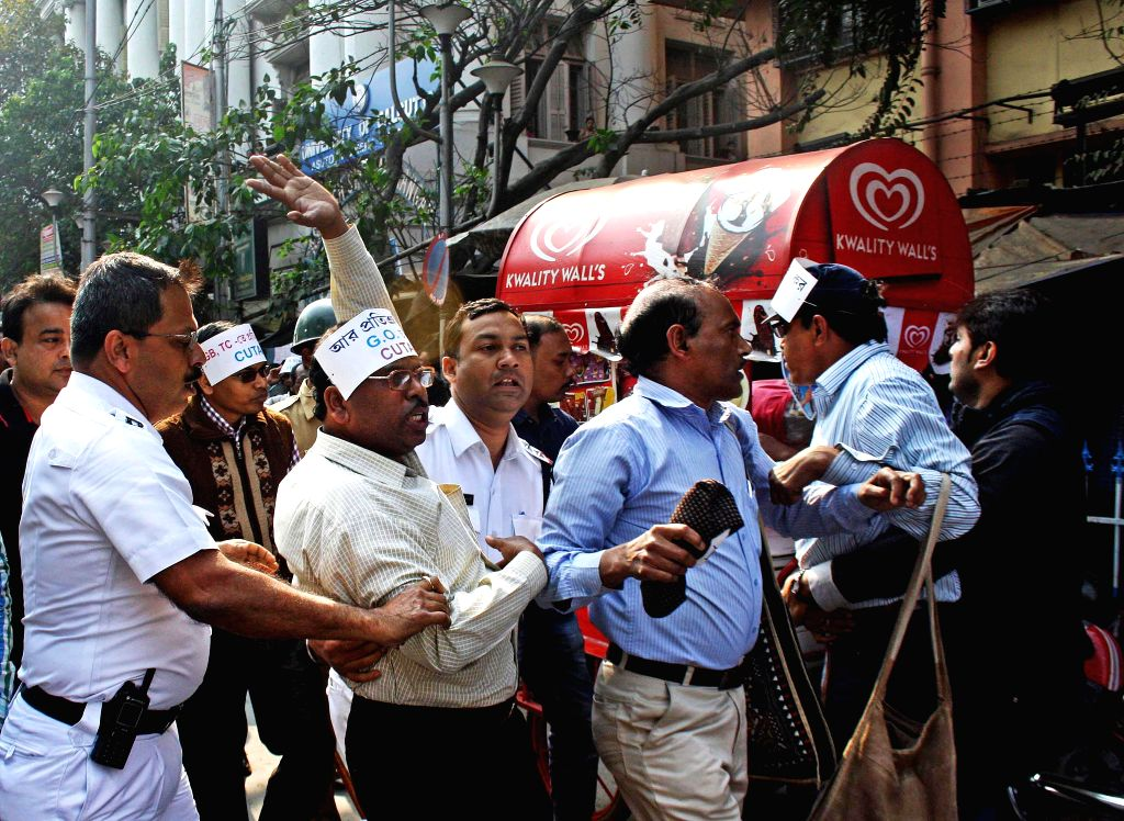 The members of College and University Teacher`s Association (CUTAB) participate in a protest against the West Bengal Government at college square in Kolkata, on Feb 11, 2015.