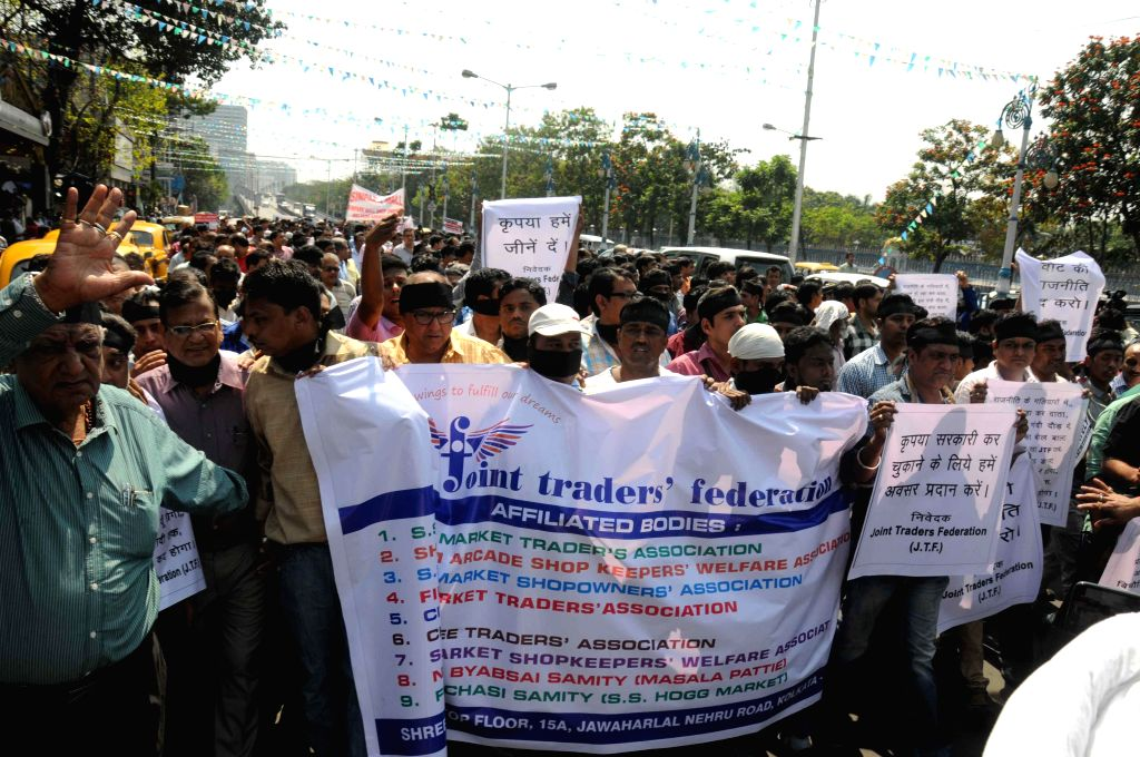 The members of Joint Traders` Federation stage a demonstration to demand  more time for payment of taxes in Kolkata, on March 11, 2015.