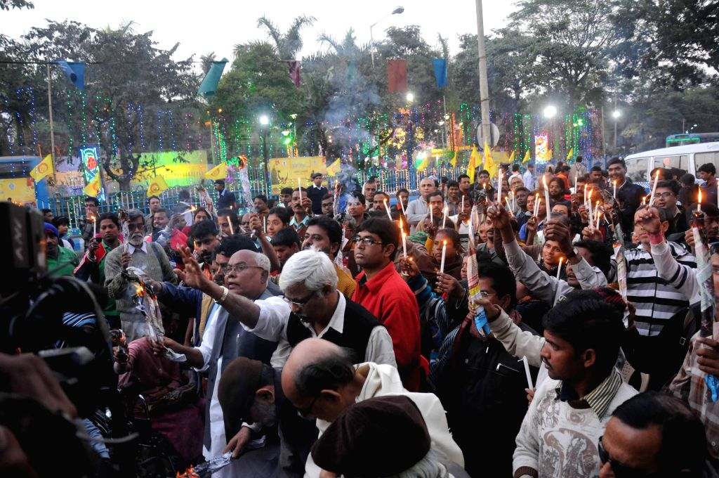The members of Pashchim Bongo Rajyo Paratibandy Sammilami stage a demonstration against the recent Assam violence in which 73 people lost their lives, in Kolkata, on Dec 28, 2014.