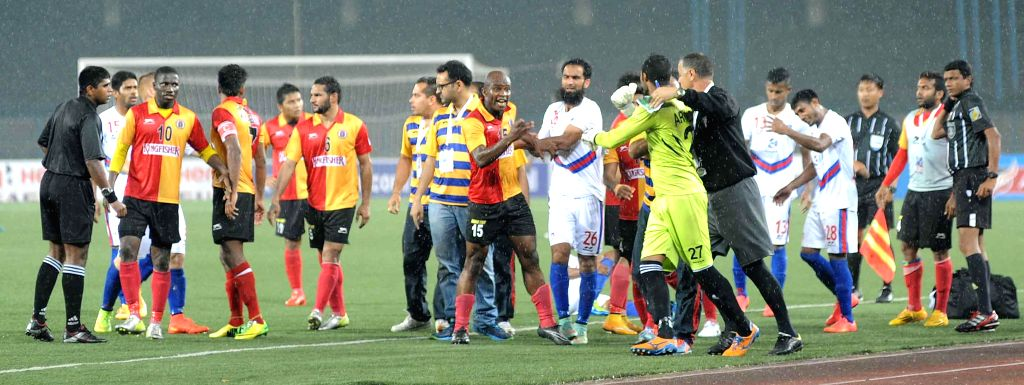 The players of East Bengal and Bharat FC get involved in a scuffle during an I-league match in Kolkata, on Feb 15, 2015. Score: 1-1.