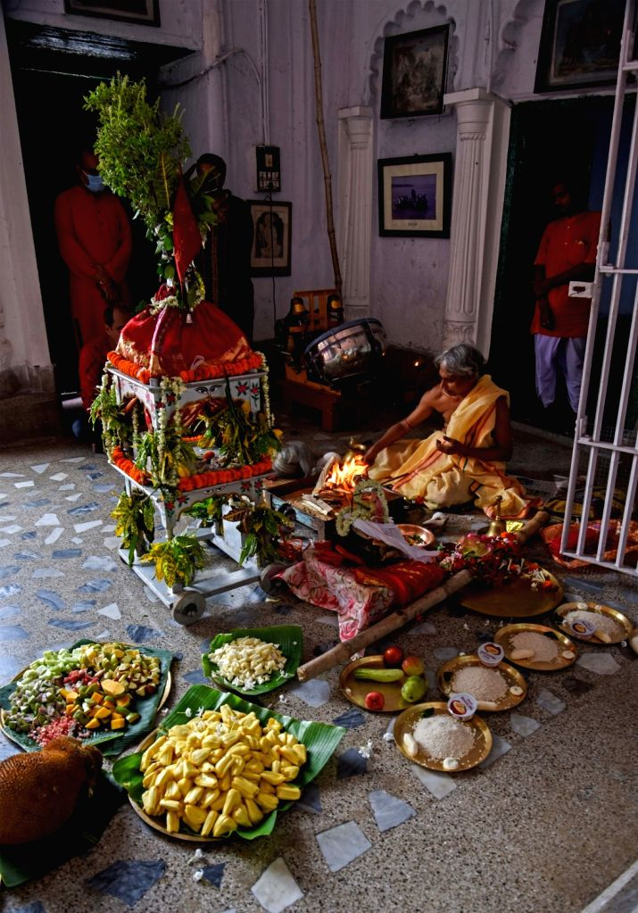 Kolkata: The present family members of Sovabazar Rajbari maintain social distancing amid COVID-19 pandemic, as they pull the rope of 255 years old traditional Rath (Chariot of Lord Narayana) while performing Khuti Puja (The Beginning of the Durga Puj