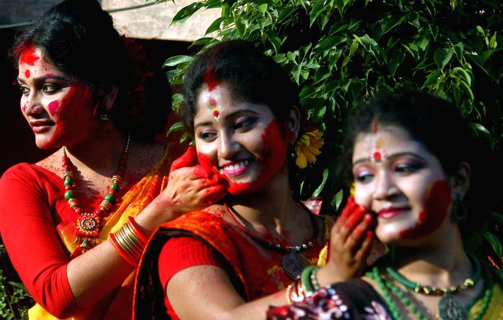 : The students of Rabindra Bharati University celebrate holi at the Jorasanko Thakur Bari campus of the university in Kolkata, on March 2, 2015.